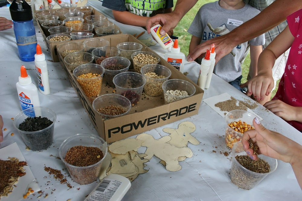 Kids make seed art at one of Ron Kelsey's activity sites.